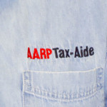 Logo or Arrp tax aide on shirt